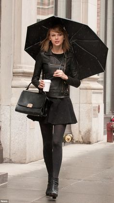 Singer in the rain  Taylor Swift stepped out in the wet weather in New York  on Saturday to grab a coffee 730b521b80148
