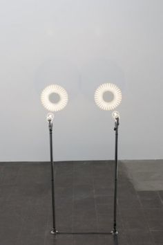 Pennacchio Argentato, 5 cent eclipse, 2012, iron, halogen lamps, electric equipment, 5 cent euro coins, magnifying glass, screens, 120 x 50 x 100 cm