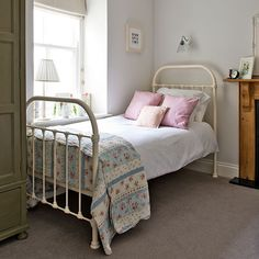 Pastel guest bedroom with iron bed   Step inside this modern country home in Cornwall   House tour   housetohome.co.uk