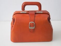 Leather Doctor bag (hand stitched)   ~ goldenponies @ etsy   ~ available in orange, black and pink