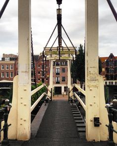 Amsterdam has so many awesome bridges!  Which ones do you like the best? These old style ones that lift for passing boats? The gentle arches along Herengracht?  This is one of my favorites. awesomeamsterdam.com #amsterdam