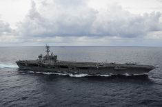 ATLANTIC OCEAN,Sept.20,2014.Aircraft carrier USS Theodore Roosevelt (CVN 71) transits in strait transit formation with Carrier Strike Group 12. Roosevelt participated in ship maneuvering drills with the guided-missile destroyers USS Forrest Sherman (DDG 98), USS Winston Churchill (DDG 81), USS Farragut (DDG 99) and the guided-missile cruiser USS Normandy (CG 60). Theodore Roosevelt is underway conducting training in preparation for future deployments.(USN Mass Comm Spec 3rd Class John…