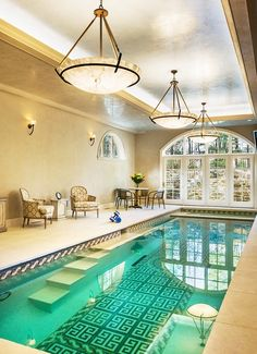 Hotels and Resorts - Elegant Indoor Pool Design In Mediterranean Hotel With Pool In Room Applied Classic Chandelier Above The Water And Dini...