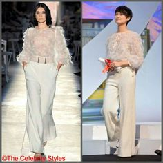 Chinese celebrity #LiYuchun was wearing Chanel FW 2012 Couture, ensemble featuring a feathered long-sleeve top and textured wide leg pants during the Closing Ceremony of the 67th Annual Cannes Film Festival on Saturday (May 24) in Cannes, France.  #Chinese #Chanel #closingceremony  #Fall2012 #Fallwinter #FW #CannesFilmFestival2014 #Cannes #film #movie #festival #saturday #France #fabulous  #detail ##fashion #WhoWearsWhat #WhoWoreWhat #beautiful #luxury
