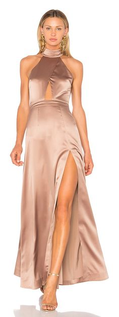x REVOLVE Zendaya Gown by NBD. A red carpet worthy number fit for a stunning starlet - the NBD Zendaya Gown. Smooth satin shapes a high neck halter ...