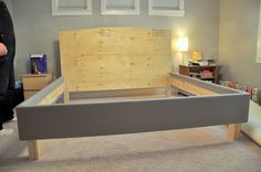 DIY upholstered bed frame and headboard. Great pictures of the process of building it on the linked site. Maybe something like this in the master bedroom with a rich tapestry fabric on the headboard and complimentary plain fabric on the box. -CAB