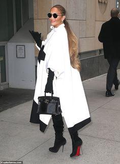 661f3127dd1 Jennifer Lopez cuts chic figure in white-and-black crescent-print cape