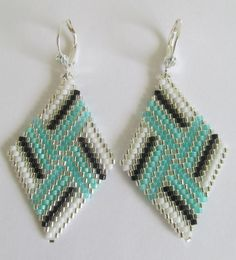 These earrings are my own original design. COPYRIGHT 2014 - Patti McAlister These pretty beadwoven earrings are handmade with Miyuki aqua frost, transparent minty aqua, opaque white, black, & silver-lined delica seed beads.  They measure 2-1/4 long which includes the plated leverback earwires, & 1-1/8 wide.
