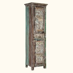 """Maximize your space and your style with this beautifully handcrafted skinny cabinet.  The Carved Wooden Mosaic Reclaimed Wood 71"""" Narrow Armoire stands off the floor on short legs.  The artistic doors feature handmade wooden tiles with abstract designs.  Storage options include a top and a bottom cupboard, each with two shelves.  There's also a middle drawer.  This tall yet compact cabinet fits neatly in corners, narrow spaces and between larger pieces."""