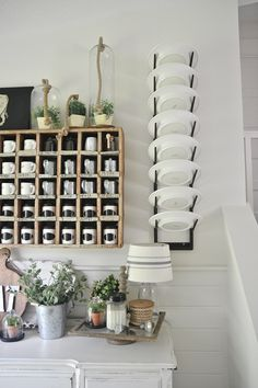 @lizmariegalvan's wall-mount plate rack is a smart storage idea for a small kitchen!