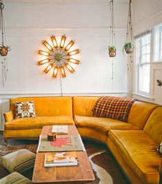 Vintage mustard sectional. Love the Sunflower light fixture & wood table. :) Awesome!~