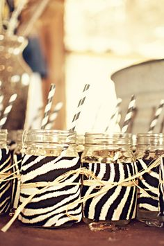 Cute way to dress up mason jars as drink jars using fabric of your choice .