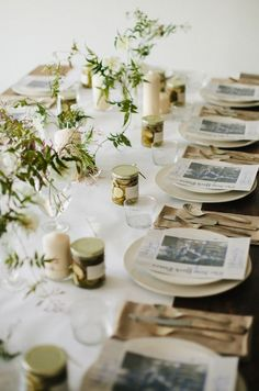Newspapers at place settings for brunch. /