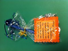 Very cute end of the year gift for preschool students--add Hershey's hugs and kisses, smarties and a noisemaker.
