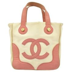 Chanel Cc Hand Canvas Vintage Italy Pink, White Tote Bag. Get one of the hottest styles of the season! The Chanel Cc Hand Canvas Vintage Italy Pink, White Tote Bag is a top 10 member favorite on Tradesy. Save on yours before they're sold out!