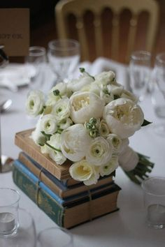 Peony and ranunculus wedding bouquet- alternate colors desired And vintage books as centerpieces!!!!!