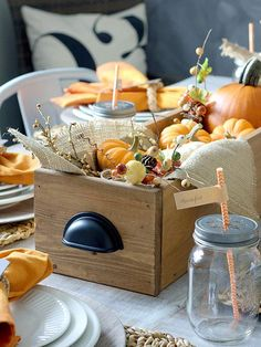 Wooden boxes can be used for all manner of things, including a centerpiece idea for your Thanksgiving table! Get 30 more fall table decorating ideas!