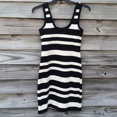 Black and white striped, knit tank dress Never worn black and white striped tank dress. 16 inches armhole to armhole. 14 inches at waist. 17 inches at hips. 36 inches shoulder to hem. Willow & Clay Dresses