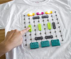 Shirt Circuit is soft wearable breadboard with modular DIY circuit components that can be snapped onto the shirt by the wearer. The motivation behind shirt circuit is to challenge the 'black box' paradigm in which STEM education is often delivered. This is done through making and playing.Making:Shirt circuit comprises of DIY components that children can build collaboratively with the help of their parents, teachers or even other peers. We have broken the making process down into small…