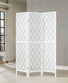 chic and this folding screen features a white honeycomb pattern