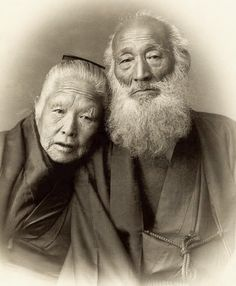Portrait of an elderly couple in traditional kimono.  Photo taken during the 1890's, Japan, by photographer Kazumasa Ogawa