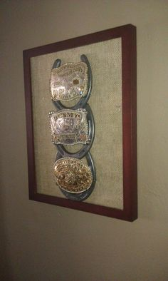 If you know of anyone who has been in rodeos, this would be a nice gift with their winnings.   Cowboy/Cowgirl Western Belt Buckle Display with Horse Shoes