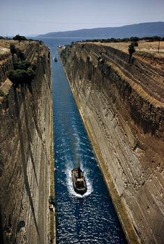 Boats ferry through a canal to bypass the Peloponnesus in Corinth, Greece, December 1956. PHOTOGRAPH BY DAVID BOYER, NATIONAL GEOGRAPHIC