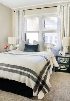 Our {Pre-Baby} Mini Bedroom Makeover   Curtains are hung high and wide