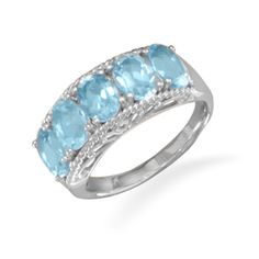 This brand new ring has a solid genuine stamped .925 sterling silver band and it features five oval shaped genuine Blue Topaz stones measuring 5 millimeters by 7 millimeters! The band features a stylish cut out swirl design along the edge of the stones and this gorgeous ring is available in whole...
