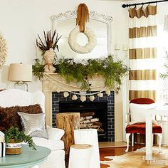 layering strands of different garlands on fireplace mantel, Christmas decorating, living room