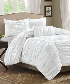 Instantly transform any bedroom with this attractive duvet set. Including all the shams and pillows needed to complete a polished look, this cozy set comes relaxation ready.
