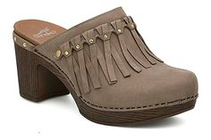 On-trend fringe and studs add style to the Dansko Deni open-back clog!