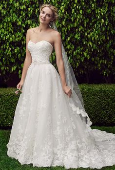 Brides: Casablanca Bridal. Cherry Blossom is classic ball gown silhouette with layers upon layers of soft tulle and hand-beading. The sweetheart neckline and accented waist are decked in hand-beaded lace and immaculate beadwork that extends to the scallop lace hemline of the train.