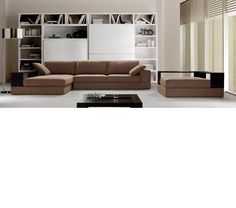 Anthem - Brown Fabric Sectional with Ottoman-Brown colored sectional sofa and ottomanWenge colored wooden ledge on ottoman and chaiseSoft paddingPillows includedAvailable in grey colorOttoman may fit where the chaise is and seal off the sofa's side