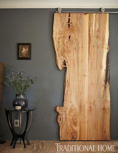 A live edge black walnut sliding door would be pretty funky