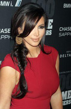 Kim wears a fashionable fishtail braid her own way with a teased crown of hair. #kimkardashian #hair