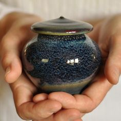 Artist Made Urns at Lucy Fagella Pottery. Here you will find handmade porcelain urns and biodegradable clay urns for your loved ones.