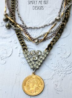 This is a Gorgeous Layered Necklace with a Stunning Sparkling Vintage Rhinestone Centerpiece. Dangling a Golden French Find. Scattered Silver and
