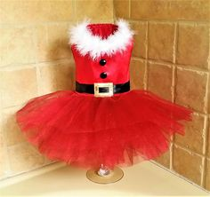 Dress A -Its almost Christmas! This Sassy Santa Tutu dress features a bright red bodice complete lined and adorned with white feather boa trim, black buttons, a classic black belt and gold buckle applique. The skirt has layers of puff tulle. Dress B -Sant Dog Clothes Patterns, Pdf Sewing Patterns, White Feather Boa, Dog Tutu, Dog Dresses, Tutu Dresses, Green Satin, Pet Clothes, Dog Clothing