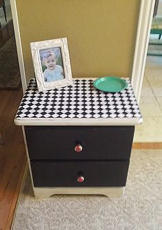 Black & White Geometric Design fun nightstand with fancy red wooden knobs. Bought a broken little pine wood stand and painted black & white, added modern design fabric top with Mod Podge, then added fun red colorful wooden knobs for a splash of color. Shabby Chic, Distressed Furniture.