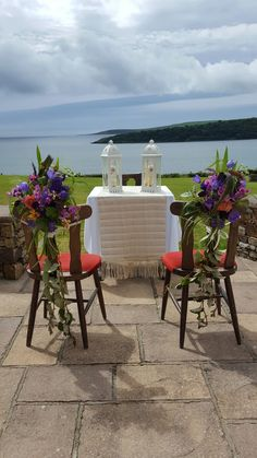 Simple rustic flowers on an undressed chair give both a natural and country vibe.