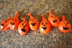 blow up orange balloons. Kids get a black marker and have to draw the face on their balloon (Jack O Lantern) Not using their hands. Can use mouth, feet, etc. First one done or best one gets a prize
