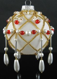 Beaded ornament in Gold-White-Red by Weaverbird Beads, no info - just an interview (this is an idea)
