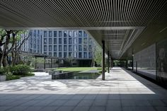 Image 16 of 25 from gallery of A Garden by the Side of a Wetland—Xixi International / gad. Photograph by Su Shengliang Landscape Architecture, Architecture Design, Space Group, Arch House, Building Images, Facade Design, Atrium, Canopy, Interior And Exterior