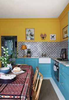 Paint colour ideas and inspiration for a sunny kitchen. Babouche paint from Farrow & Ball adds a touch of sunshine to a kitchen with pale turquoise cabinets