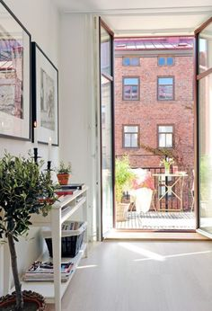 Airy. White. Bright.  Love the doors that open up to small patio