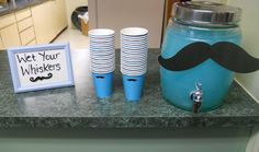 drink station at a mustache baby shower