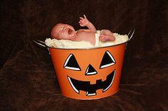 newborn in halloween bucket
