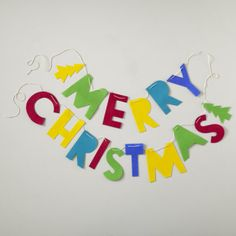 Kids Holiday Decor: Merry Christmas Garland - Merry Christmas Garland. Colorful felt garland not only adds a little Christmas cheer to your home, but it also serves as a great reminder for what holiday you're celebrating. Details, details - Nod exclusive - Garland spells out Merry Christmas in five bright colors - Features a Christmas tree at each end - Letters measure 6 high Show 'em what you're made of - Felt - White hanging string. Price: $12.95