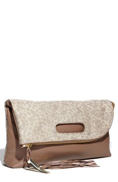 Every gal needs a great fold over clutch...I need a great little fold over clutch!